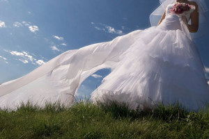 Beautiful bride on the sky background